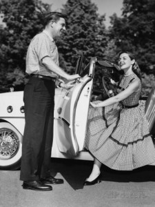 man-holding-car-door-open-for-woman
